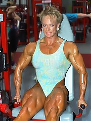 Paula Bircumshaw showing off some of the most massive muscularity - huge biceps and triceps, a power-laden back and very developed thighs